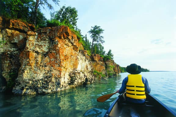 Canoeing at Little Limestone Lake Provincial Park in Manitoba, Canada.